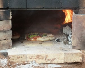 Pizza with farm fresh ingredients, in the wood fired oven.